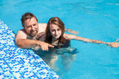 Father and daughter swimming in the poo — Stock Photo