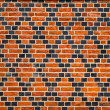 Decorative ornament made by red and black bricks — Stock fotografie