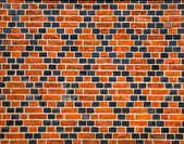 Decorative ornament made by red and black bricks — Stock Photo