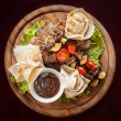 Meat and vegetable delicacies — Stockfoto