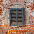 Rusty metal window on  brick wall — Stock Photo