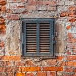 Rusty metal window on brick wall — Stock Photo #31959495