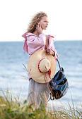 Woman standing on beach near sea — Stock Photo