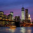 Foto Stock: Manhattat night with lights and reflections