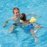 Father teaching his son to swim — Stock Photo #34005691