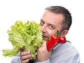 Man holding lettuce isolated on white — Stock Photo