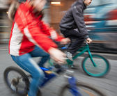 Two young boys on bicycles in the city — Stock Photo