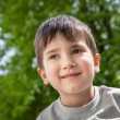 Happy little boy smiling — Stockfoto