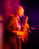 Saxophone player performing on stage — Stock Photo