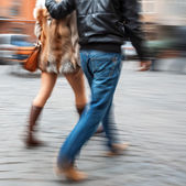 Young man and woman walking down the street — Stock Photo