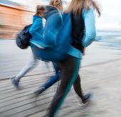 A group of young people going along the street — Stock Photo