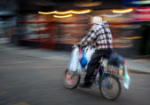 Old man riding a bicycle — Stock Photo