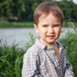 Stock Photo: Child with dandelion outdoor