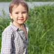 Stock Photo: Little boy near river