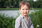Child with dandelion outdoor — Zdjęcie stockowe