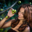 Stock Photo: Young womwith wild apples