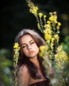 Portrait of a young woman in flowers — Stock Photo
