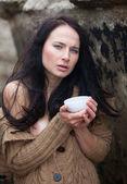 Woman drinking tea outdoors — Stock Photo