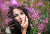 Beautiful girl among the flowers — Stock Photo