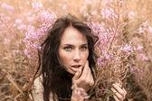 Beautiful girl among the flowers — Stock Photo