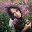 Stock Photo: Beautiful girl among flowers