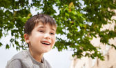 Happy little boy smiling — Stock Photo