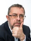 Portrait of senior businessman in a black jacket — Fotografia Stock