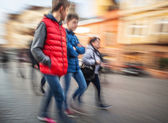 young people group hurrying about their business — Stock Photo