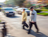 Group of people crossing the street at a crosswalk — Stock Photo