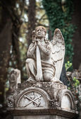 Statue on grave in the old cemetery — Stock Photo