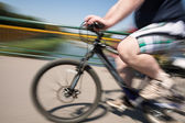 Fat man rides a bicycle — Stock Photo