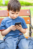 Little boy with smartphone — Stock Photo