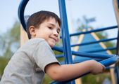 Boy playing on the playground — Stock Photo