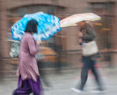 People walking down the street in rainy day — Stock Photo