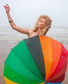 Naked girl with a colorful umbrella — Stock Photo