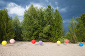 Landscape with colored balloons — Stock Photo