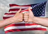 Thumbs up sign against of USA flag — Stock Photo