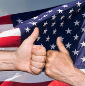 Thumbs up sign against of USA flag — Foto Stock