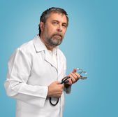 Doctor in a white coat — Stock Photo