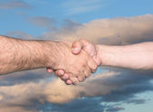 Handshaking.  — Stockfoto