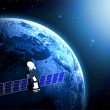 Blue planet earth and satellite in space. — Stock Photo #25295267
