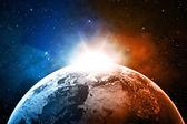 Planeta ziemia z wschód w przestrzeni — Zdjęcie stockowe