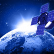 Blue planet earth and satellite in space - Stock Photo