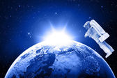 Blue planet earth and satellite in space — Stock Photo