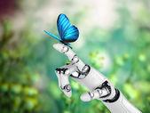 Roboter-hand und schmetterling — Stockfoto