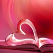 Pink open book and heart — Stock Photo