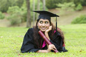 Indian female graduate with thumbs up — Stock Photo