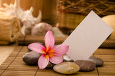 Tropical spa with frangipani flowers — Stock Photo