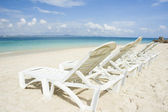 Beach with chairs — Stock Photo