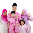 Malay family in traditional malay clothing - Stockfoto